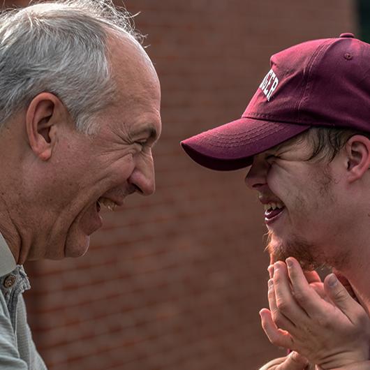 Man smiling at his son
