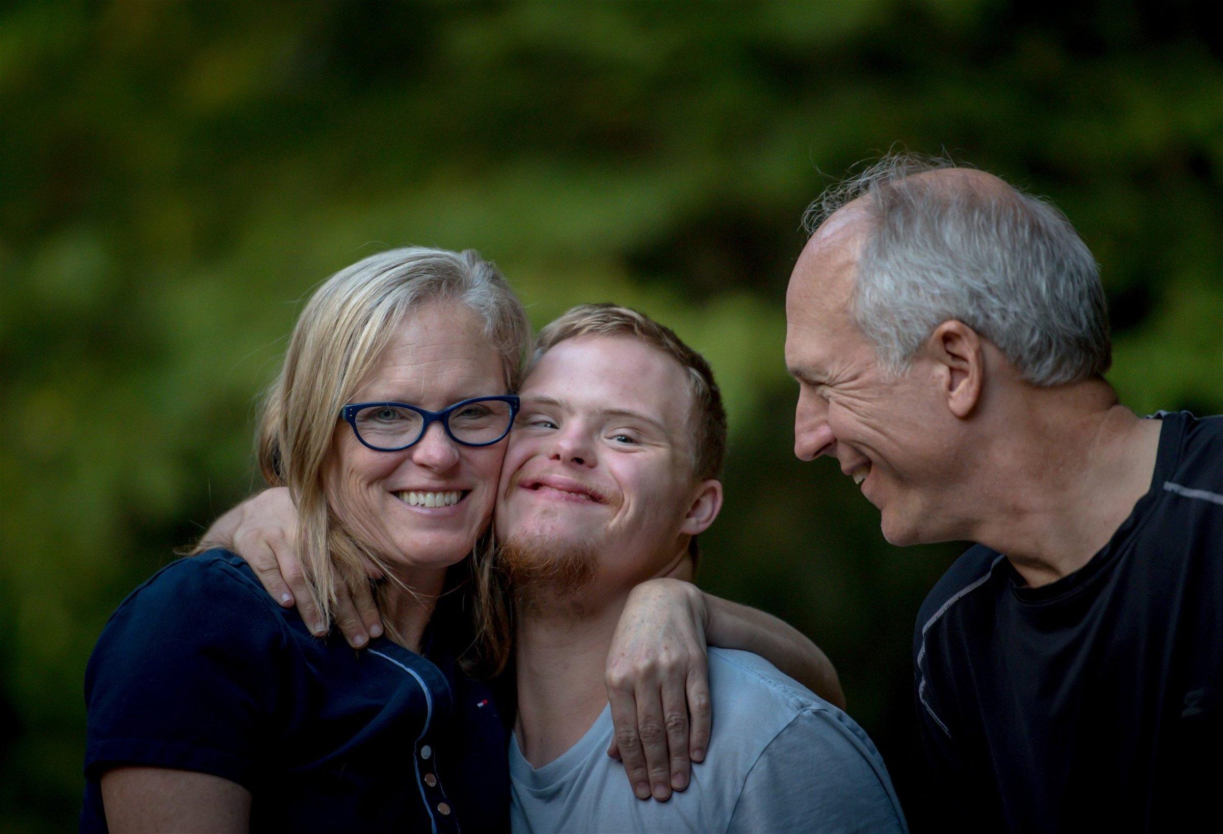 parents embracing adult child
