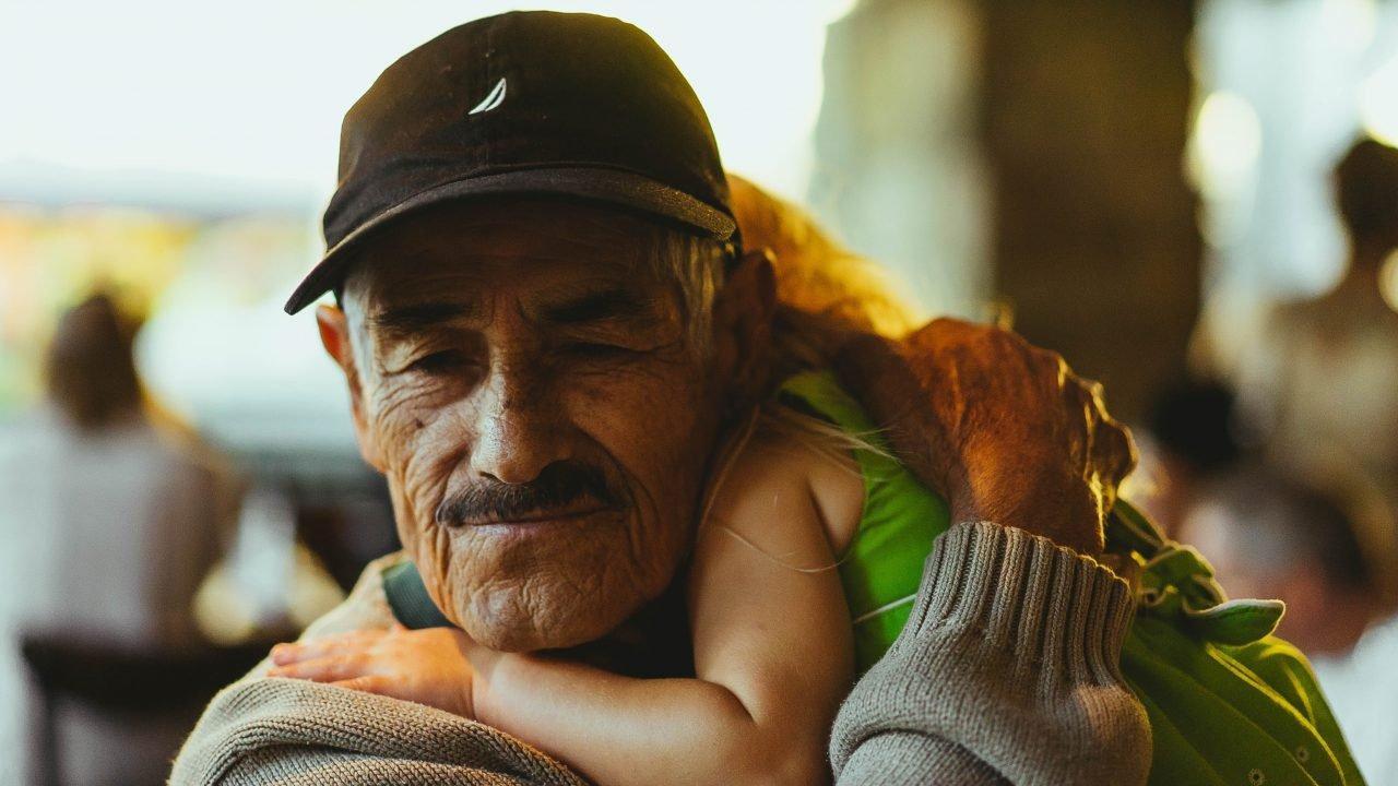 Child hugging older man