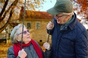 Man beside a woman on a swing