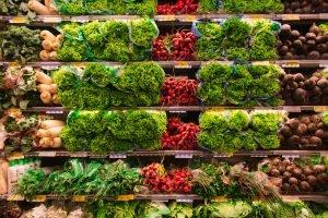 Fresh vegetables on grocery store shelves