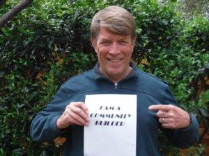 Empowerline Volunteer David Bohanon Holds Up Sign